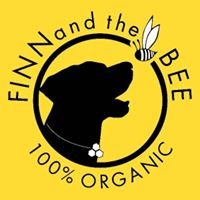 "A silhouette of a black lab and a bee, ""Finn and the Bee 100% Organic"""